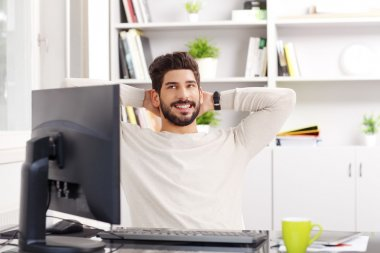 Relaxing professional near computer
