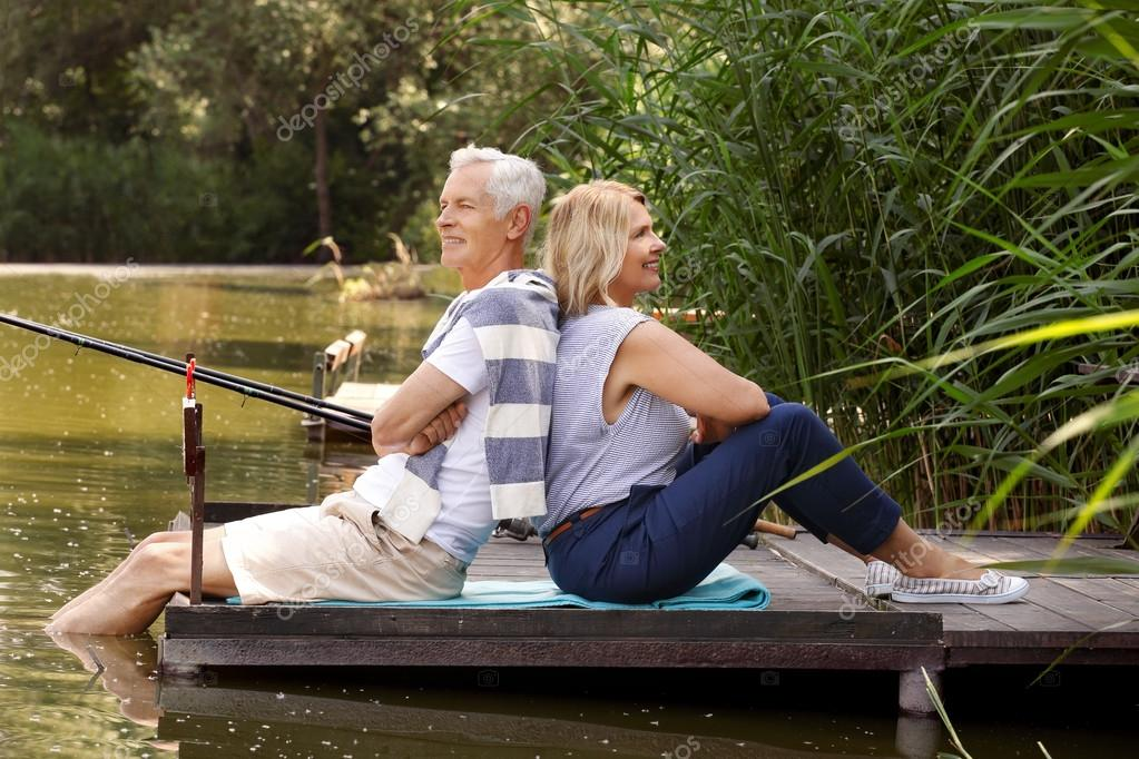 Happy old age couple fishing