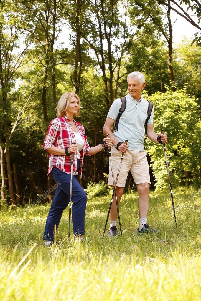 Active senior couple enjoying a nordic walk
