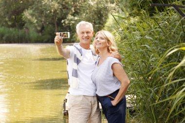 Senior couple taking selfie