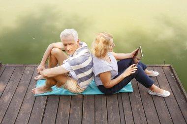 Senior couple relaxed on pier