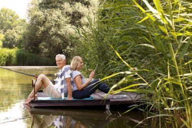 Senior couple at lake shore