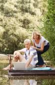 Fotografie Seniorenpaar mit Laptop