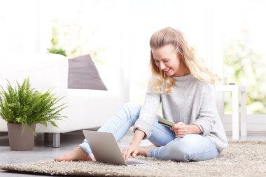 Smiling woman paying bills online