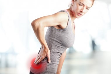 Woman feeling pain in lower back