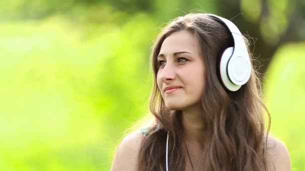 girl in headphones on nature