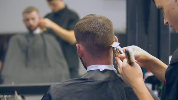 Haircut of a young guy in a hairdresser