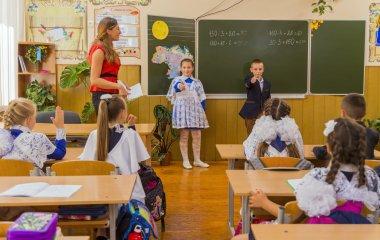 Pupils near blackboard