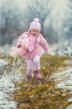 little girl runs