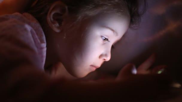 child watches cartoons