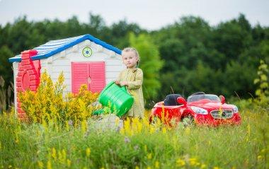 little girl watering flowers