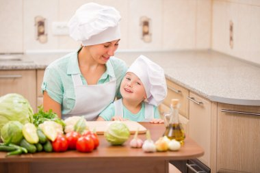 mother with her baby chefs
