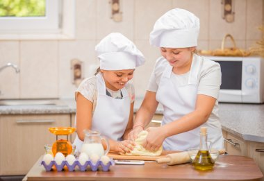 two girls cook