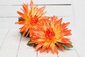 Fotografie Fake orange flowers