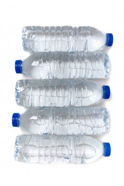 Row of plastic water bottles isolated on a white background.