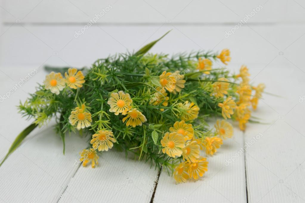 Fake yellow flowers stock photo membio 100709982 close view of fake yellow flowers isolated on a white wooden background photo by membio mightylinksfo