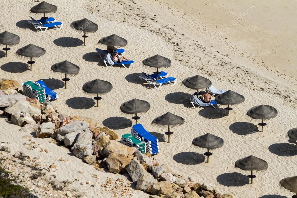 section of straw umbrellas on a beach