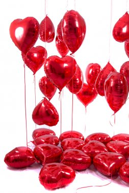 bunch of red heart balloons