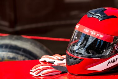 Red helmet with gloves