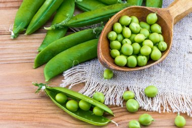 Fresh green peas and spoon