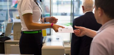 Handing over air ticket at airline check in counter