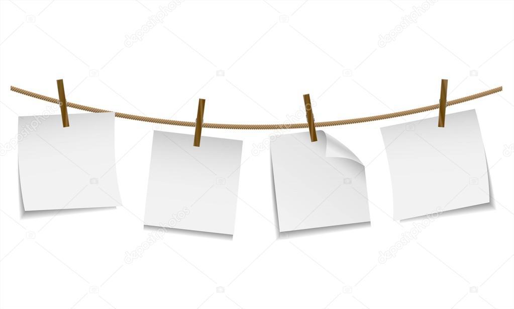 En blanco papel blanco colgado en el tendedero con pinza - Tendederos de ropa de pared ...