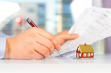 Real estate investment. Signing the loan papers. stock vector