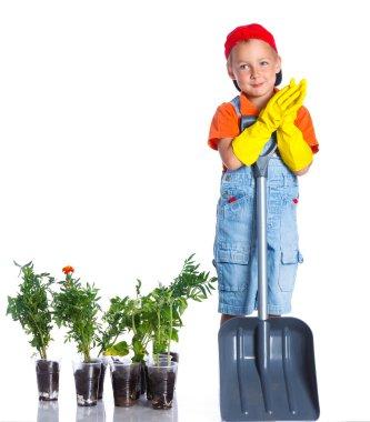 Cute boy gardener