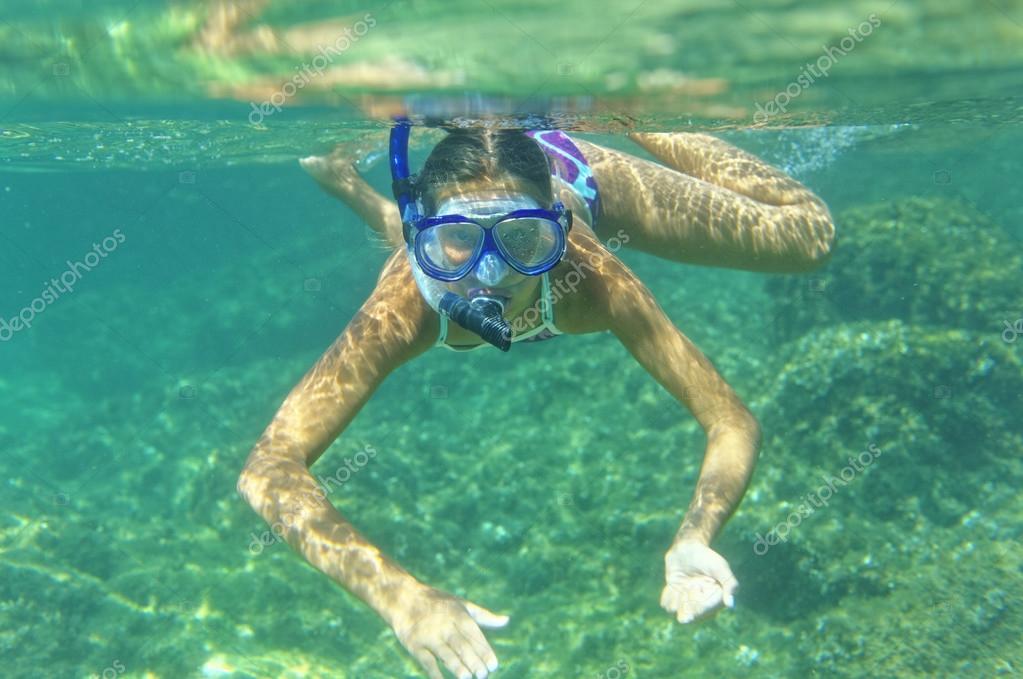 Underwater girl snorkeling