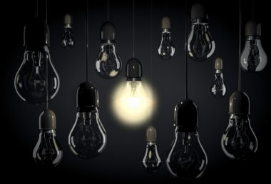 Hanging light bulbs on wires in blackroom