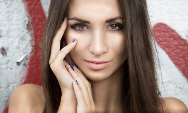 portrait of sexy brunette woman with perfect face looking at cam
