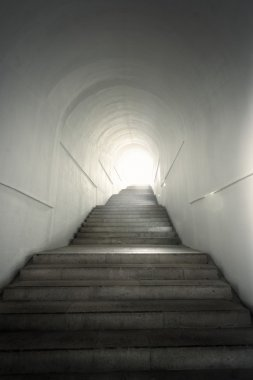 Light of the end of tunnel with stairs