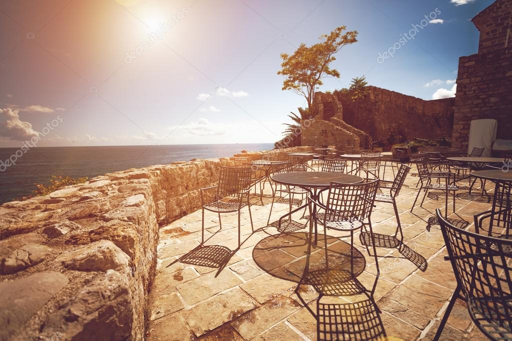 Toned photo of restaurant summer terrace at sunny day