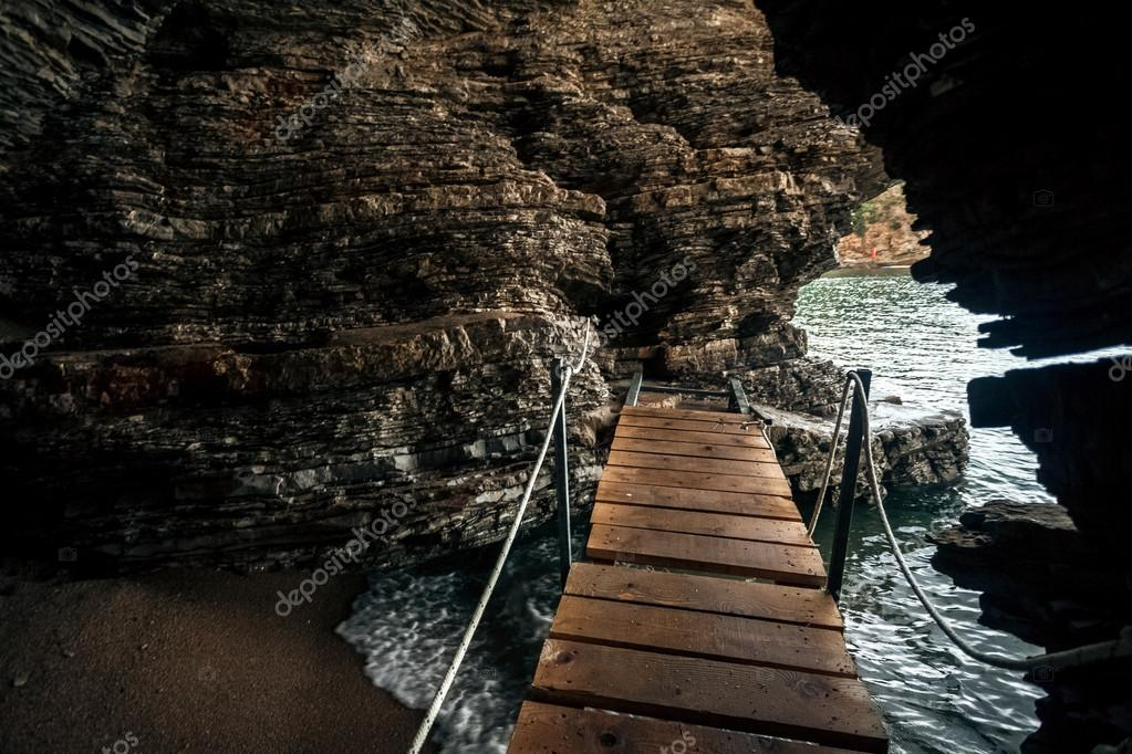 view from inside of the sea cave with wooden path