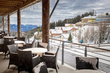 terrace covered by snow at ski resort restaurant