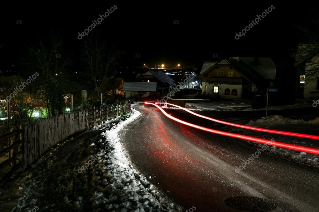 red and white light trails of cars at old Austrian town