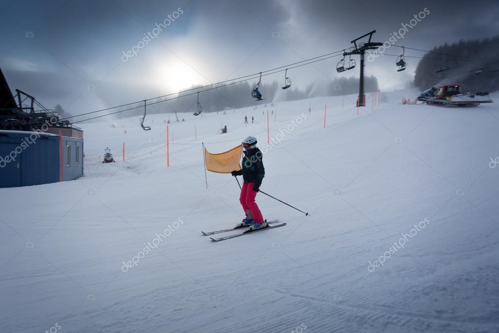 woman riding down the ski slope in Austrian ski resort