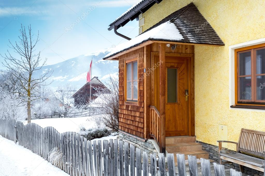 wooden porch covered by snow in Austrian Alps
