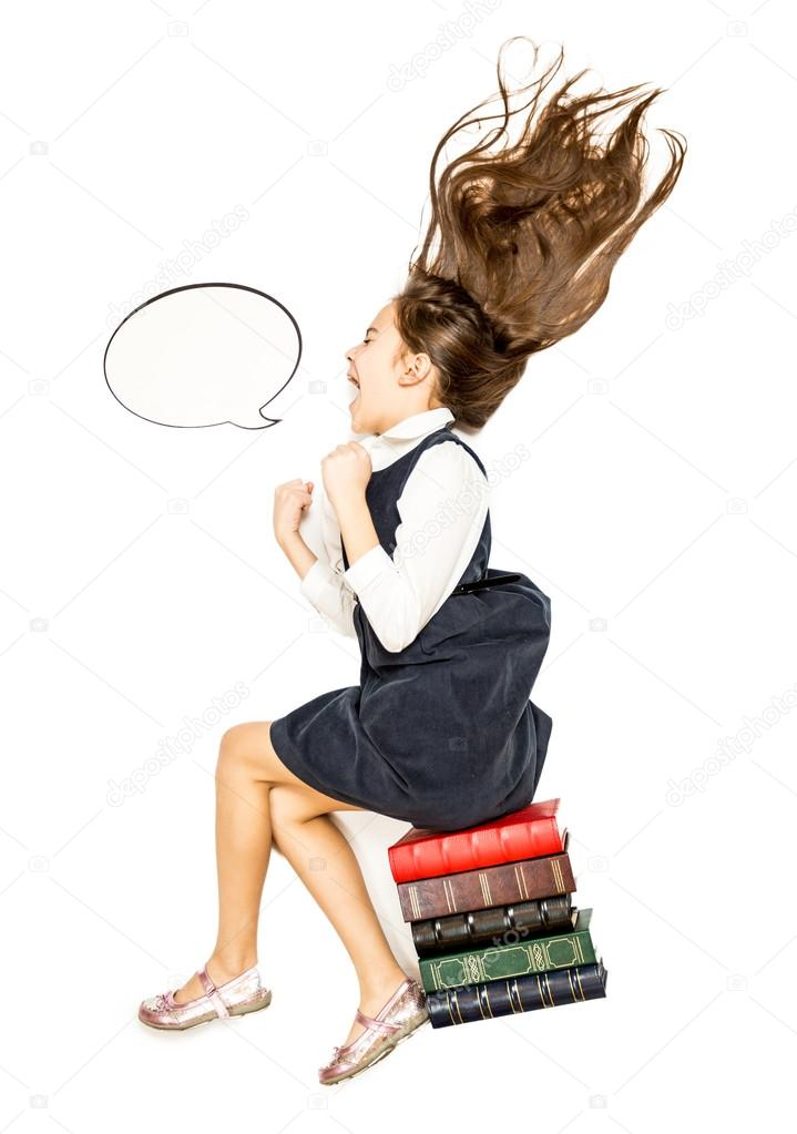 High point of view of little girl sitting on books and shouting