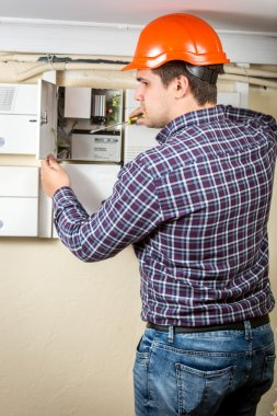 electrician repairing electrical board at home