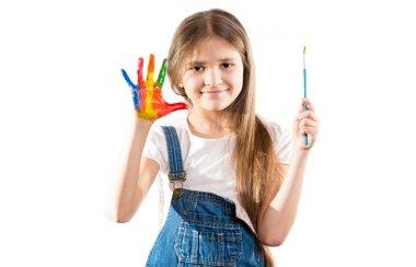 little artist girl showing painted hands