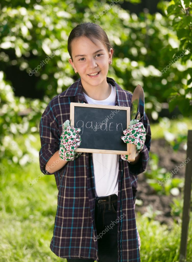 Happy smiling girl holding blackboard with word