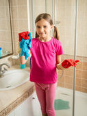girl with pigtails posing at bathroom while doing cleaning