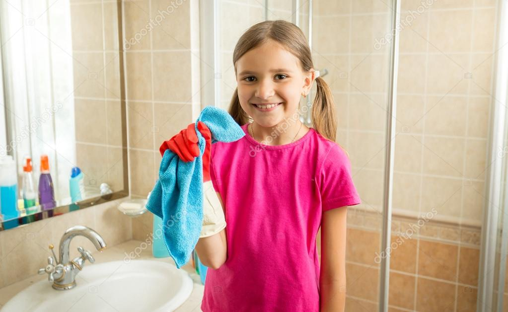 cute girl doing cleaning posing with blue rag