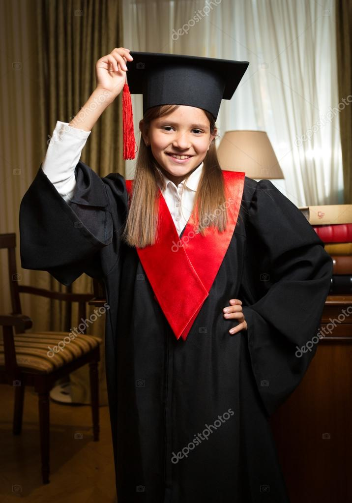 girl in graduation cap and gown posing at classic interior — Stock ...