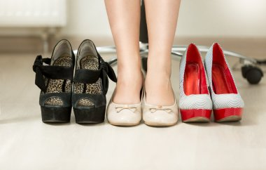 conceptual photo of woman choosing most comfortable shoes