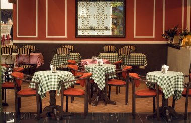 Toned image of italian restaurant interior with wooden chairs an