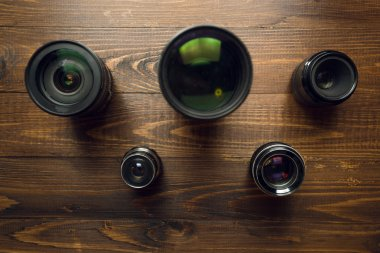 Concept of Olympic games. Top view on camera lenses in shape of