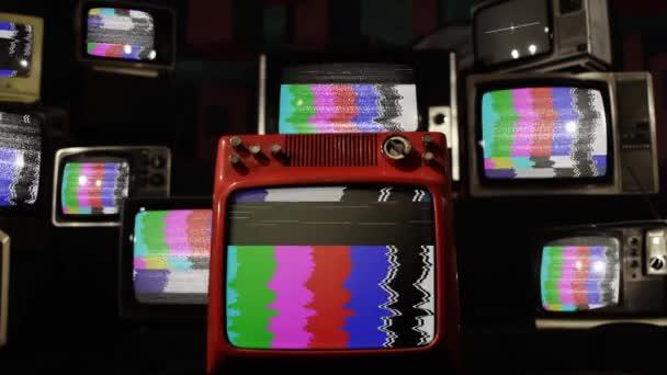 Színes rudakkal és statikus zajjal rendelkező retro televíziók.