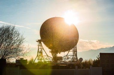 Satellite dishes on summit at sun day